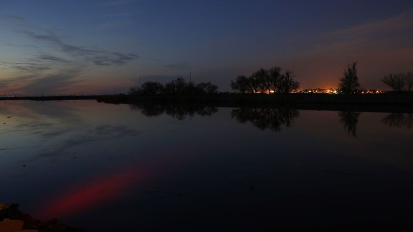STOCKTON, CA - Feb. 25, 2016: The sunset is reflected in the Middle River in the Sacramento-San Joaq