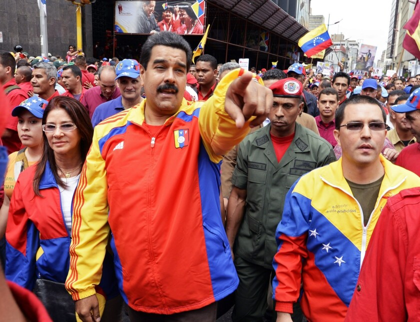 Venezuelan Vice President Jorge Arreaza, right, President Nicoals Maduro, center, and First Lady Cilia Flores, left, lead a demonstration in Caracas on Aug. 3 against corruption.