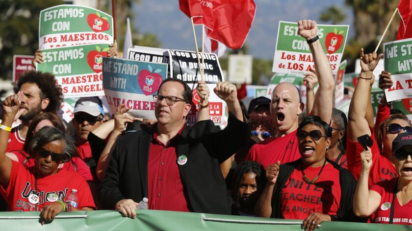 United Teachers Los Angeles President Alex Caputo-Pearl, center, joins teachers at a rally next to the Broad Museum in Los Angeles on Dec. 15, 2018.
