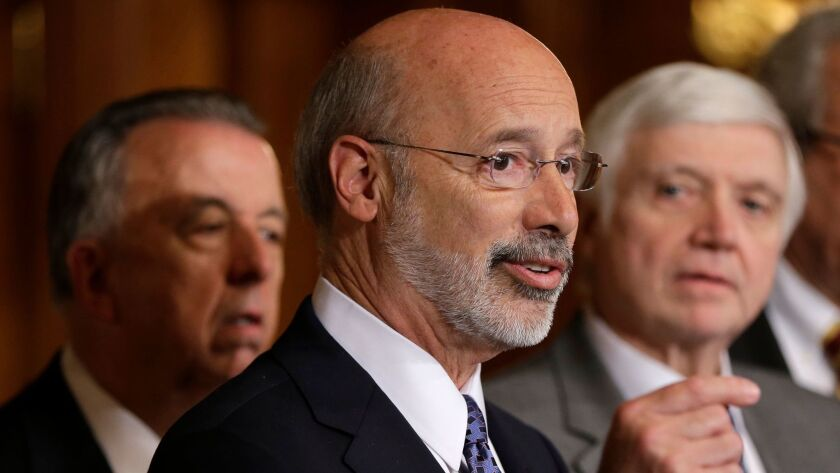 FILE - In this Oct. 7, 2015, file photo, Pennsylvania Gov. Tom Wolf, center, accompanied by state Ho