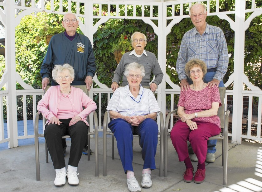 From left, couples Jim and Betty Rose Railey, Vincent and Mary Van Velzer, and Carroll and Bonnie Smith pose for a portrait at Rowntree Gardens in Stanton.