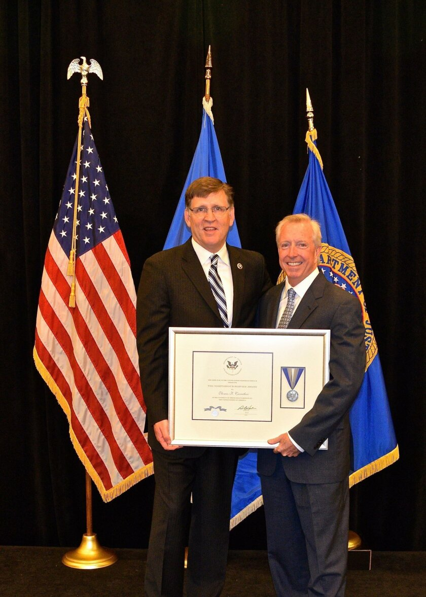 Tom Carruthers received the Meritorious Service Award from the Director of the Marshal Service David Harlow in Washington DC.