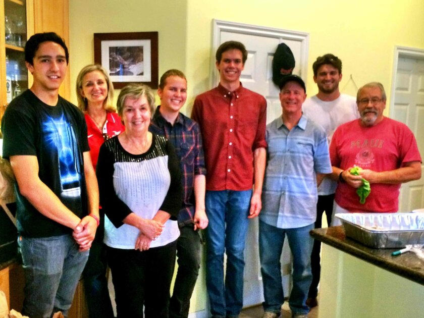 Members of Rotary and Interact after preparing the meals for delivery to homeless youth in Ocean Beach. L-R, Troy Nohra, Susan Atkinson, Suzanne Sutton, Bruce Mulmat, Griffin Danninger, Kevin Cahill, Aaron Studer, Bill Sutton.