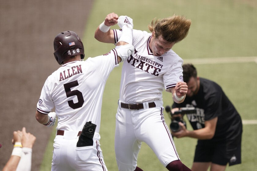 Mississippi State's Tanner Allen (5) congratulated by teammate Rowdey Jordan after hitting a home run against Notre Dame during the first inning of an NCAA college baseball super regional game, Saturday, June 12, 2021, in Starkville, Miss. (AP Photo/Rogelio V. Solis)