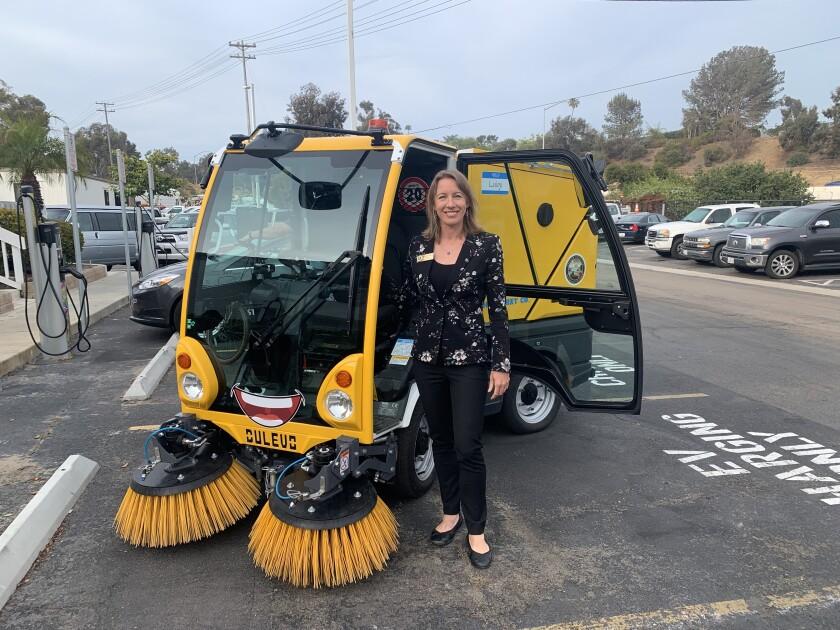 "Encinitas Mayor Catherine Blakespear with the new street sweeper, ""Luigi""."