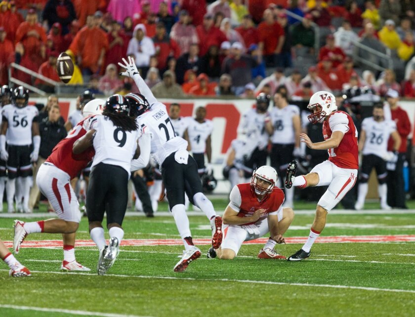 Houston's Kyle Bullard kicks the ball during the second half of an NCAA college football game against Cincinnati at TDECU Stadium, Saturday, Nov. 7, 2015, in Houston. Houston defeated Cincinnati 33-30.  (AP Photo/Juan DeLeon)