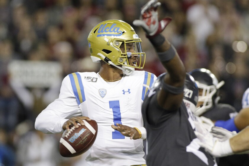 UCLA quarterback Dorian Thompson-Robinson gets ready to pass Saturday night against Washington State.