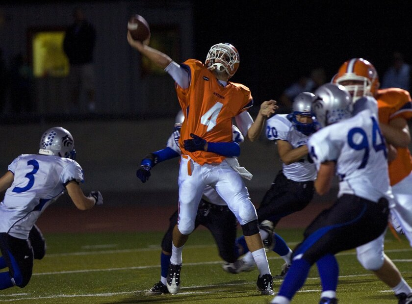 Valhalla senior quarterback Pete Thomas, who was 16-of-25 passing for 284 yards and four touchdowns, lets loose with a toss against West Hills. Thomas has accepted a scholarship offer to Arizona State. (Nelvin C. Cepeda / Union-Tribune)