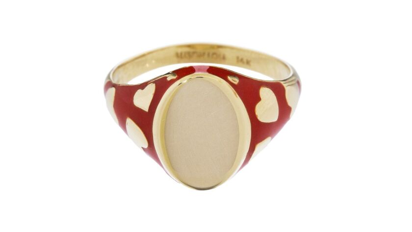 Alison Lou: Designer Alison Lou plays with the traditional shaped 14kt. yellow gold signet ring des