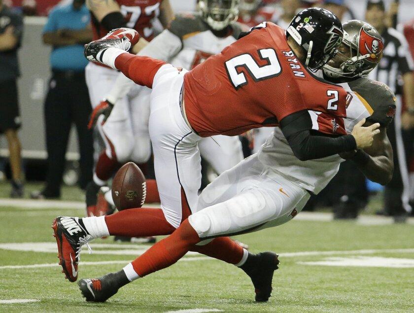 Tampa Bay Buccaneers defensive end Howard Jones (95) pulls at Atlanta Falcons quarterback Matt Ryan (2) causing a fumble during overtime of an NFL football game, Sunday, Nov. 1, 2015, in Atlanta. The Tampa Bay Buccaneers won 23-20. (AP Photo/David Goldman)