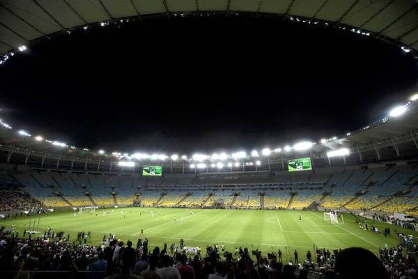 Soccer stars play a test match at Rio de Janeiro's Maracana stadium, newly reopened after extensive renovations.