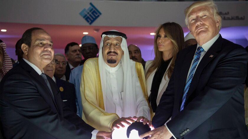 epa05980374 A handout photo made available by the Saudi Press Agency (SPA) shows US President Donald