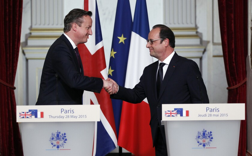 British Prime Minister David Cameron, left, shakes hands with French President Francois Hollande after a press conference at the Elysee Palace in Paris on Thursday.