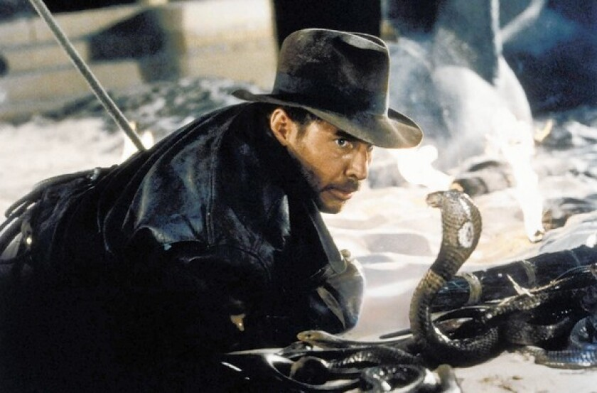 """Harrison Ford comes face-to-face with a cobra in a scene from """"Raiders of the Lost Ark."""""""