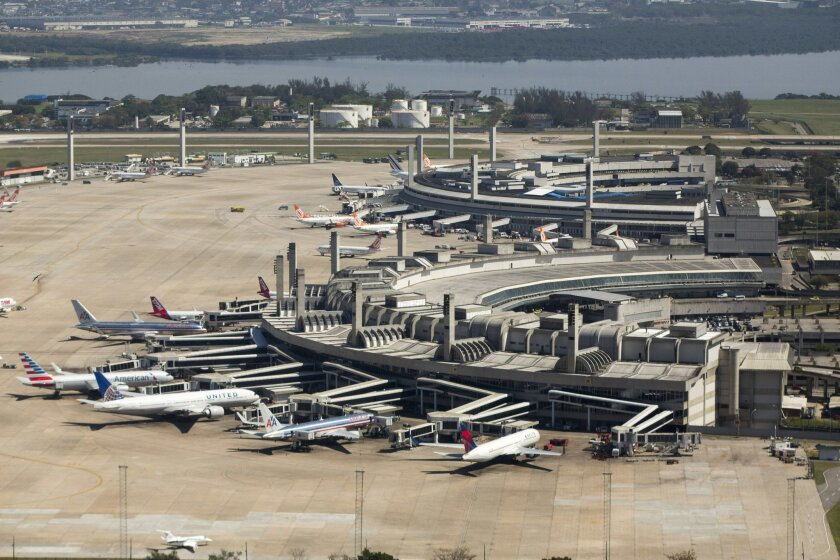 In this Sept. 11, 2013 photo released by Portal da Copa 2014, aerial view of the Galeao international airport, in Rio de Janeiro, Brazil. Brazil has decided against opening more routes for foreign air carriers for next year's World Cup. According to Civil Aviation Secretary Wellington Moreira Franco, Brazilian carriers can handle the more than 3.6 million expected soccer fans traveling to the 12 host cities. (AP Photo/Portal da Copa 2014, Daniel Basil)