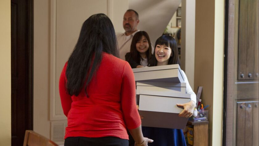 """Marie Kondo, right, in a scene from """"Tidying Up With Marie Kondo."""""""