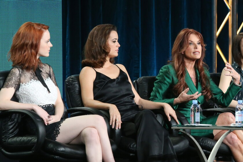 """Actors Rachel Brosnahan, left, and Cote de Pablo and executive producer Roma Downey speak during """"The Dovekeepers'"""" panel."""