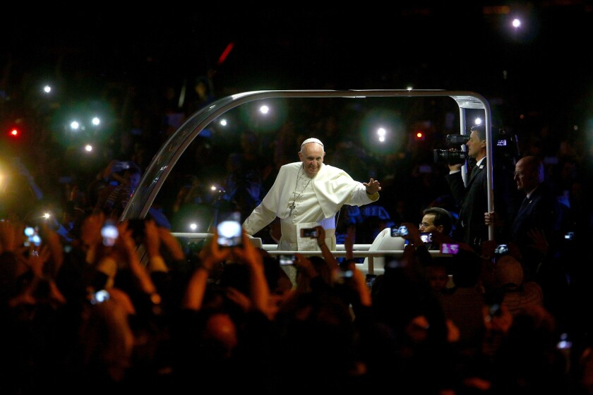 Pope Francis waves to the crowd at the Festival of Families in Philadelphia, the last city on his U.S. tour.