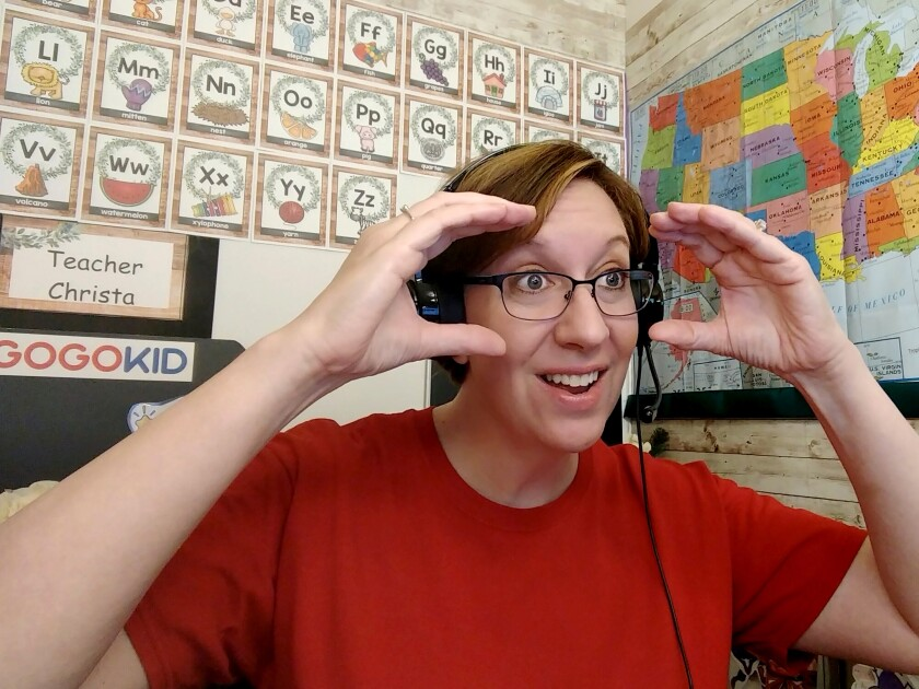 Christa Kacer-Reynolds teaches on the GoGoKid platform from her home in Iowa in early September.