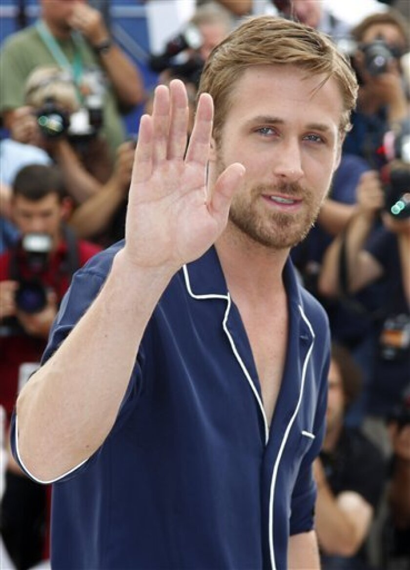 Actor Ryan Gosling waves during a photo call for Drive at the 64th international film festival, in Cannes, southern France, Friday, May 20, 2011. (AP Photo/Francois Mori)
