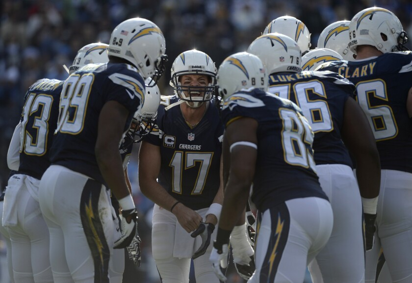 Quarterback Philip Rivers (17) runs a Chargers huddle during a game.