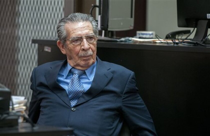Guatemala's former dictator General Efrain Rios Montt sits in the courtroom as the judge orders the suspension of the trail against him and fellow General Jose Mauricio Rodriguez Sanchez, on charges of genocide in Guatemala City, Thursday, April 18, 2013. Rios Montt seized power in a March 23, 1982 coup, and ruled until he himself was overthrown just over a year later. Prosecutors say that while in power he was aware of, and thus responsible for, the slaughter by subordinates of at least 1,771