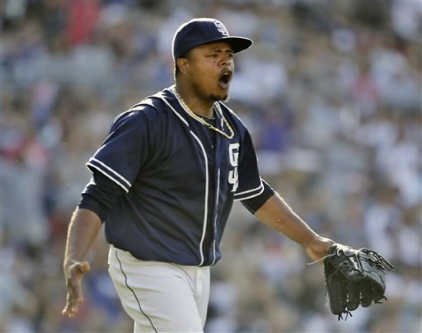 San Diego Padres starting pitcher Edinson Volquez reacts to a safe call by first base umpire Marty Foster on a would-be inning-ending double play against the Los Angeles Dodgers during the fifth inning of a baseball game in San Diego, Saturday, June 22, 2013. The Dodgers scored a run on the play.