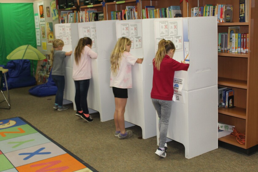Third graders cast their vote in the election.