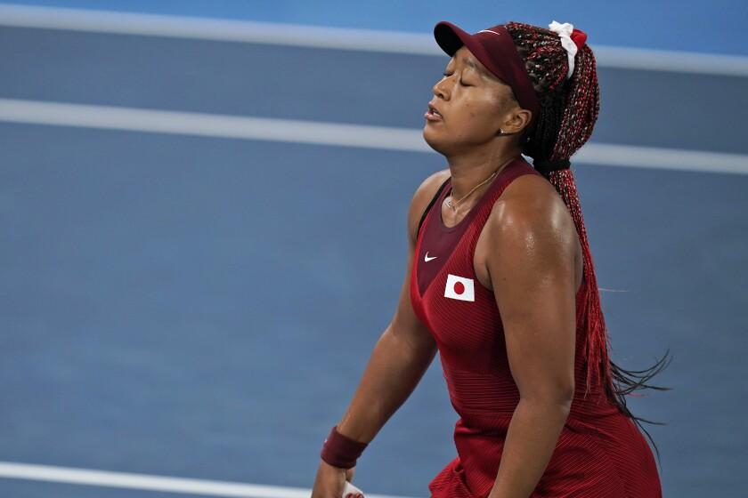 Naomi Osaka reacts after losing a point to Marketa Vondrousova during the third round of the Tokyo Olympics.
