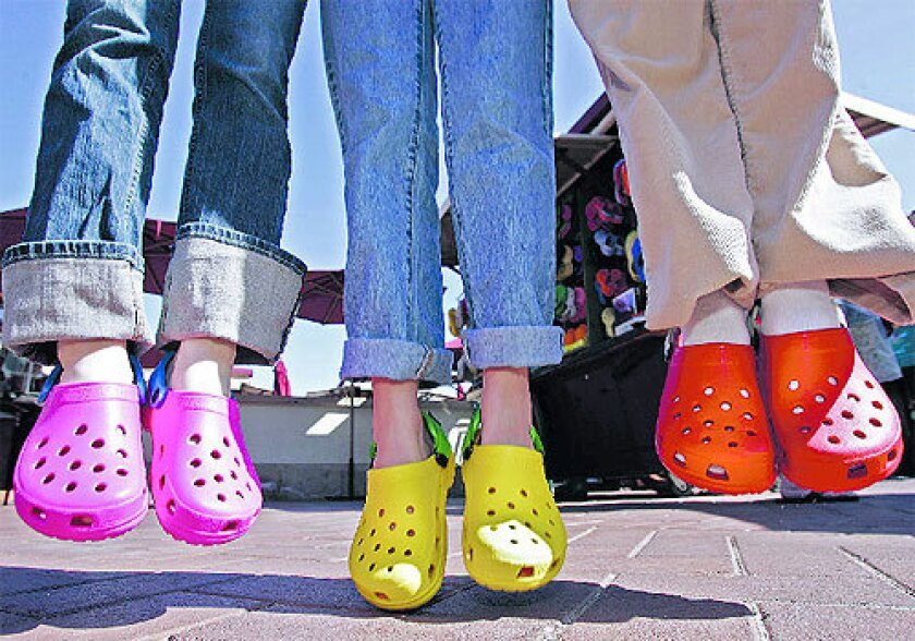 Pink, yellow and red Crocs