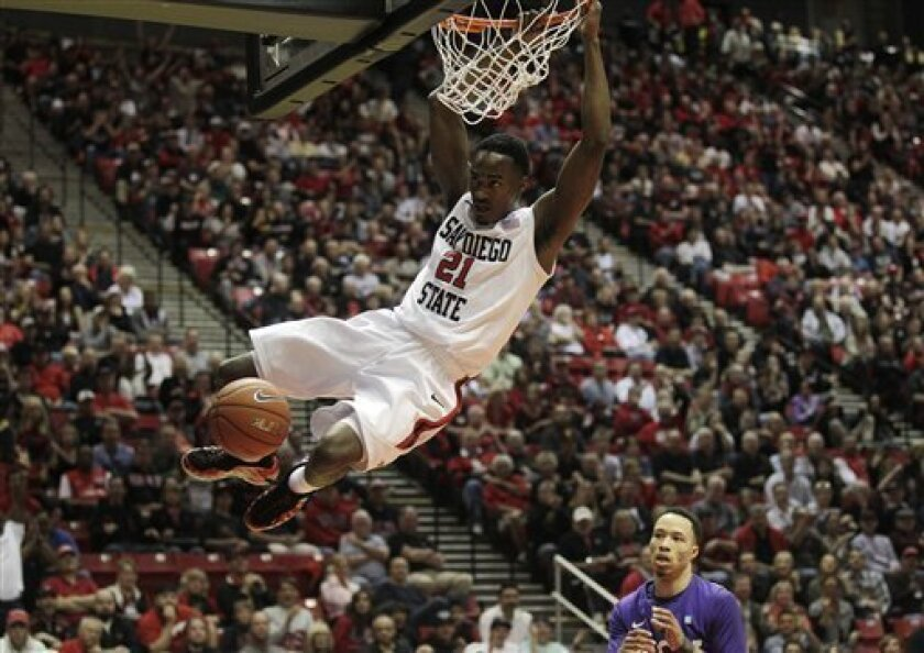 San Diego State's Jamaal Franklin, above, dunks as TCU's Kyan Anderson looks on in the first half during an NCAA college basketball game Saturday, Feb. 4, 2012, in San Diego. (AP Photo/Gregory Bull)