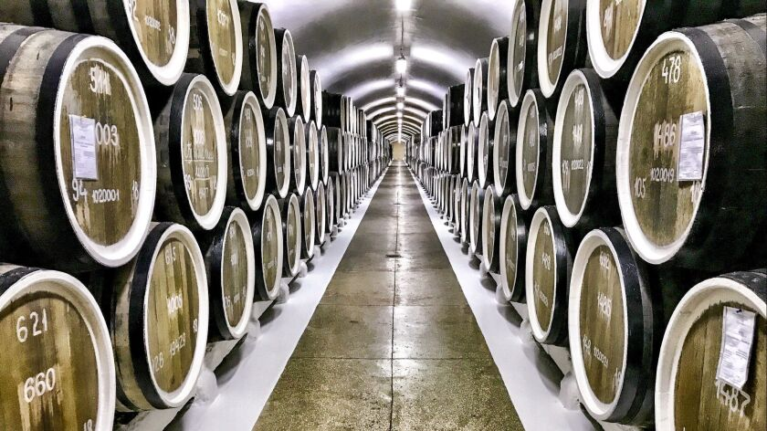 CRIMEA, RUSSIA - Barrels of wine waiting to be bottled at Massandra Winery, the largest winery in Ya