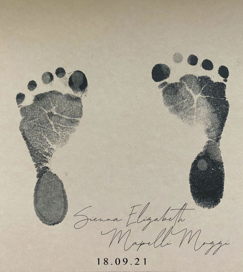 This undated handout photo provided by Buckingham Palace on Friday, Oct. 1, 2021 shows the footprint and name of the daughter of Britain's Princess Beatrice. Princess Beatrice and her husband Edoardo Mapelli Mozzi have named their newborn daughter Sienna Elizabeth. In a tweet Friday, Beatrice revealed the name alongside a picture of Sienna Elizabeth's footprints. (Princess Beatrice and Edoardo Mapelli Mozzi/Buckingham Palace via AP)