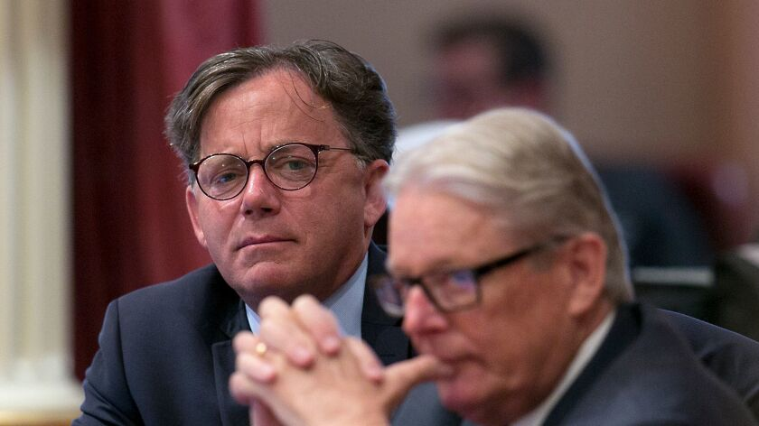 State Sen. Josh Newman, D-Fullerton, left, listens as lawmakers debate a recall election measure against him on Aug. 24, in Sacramento, Calif.