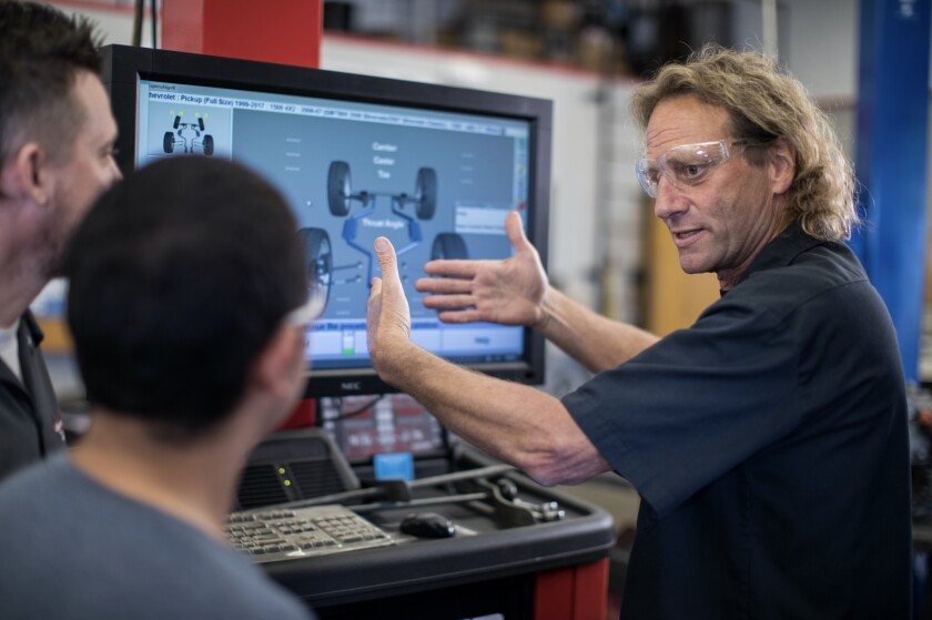 MiraCosta College Professor Steve Vail with students in the Automotive Technology Program.