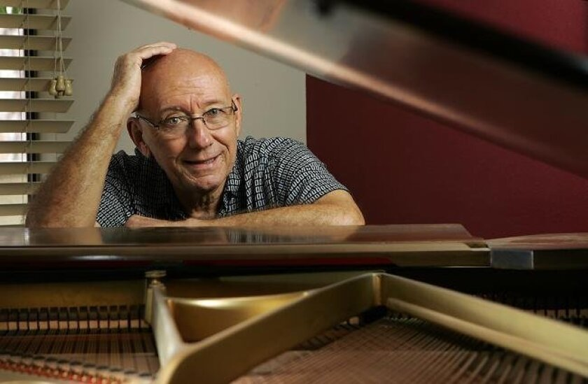 Jazz pianist Mike Wofford, at his San Diego home, has had a prolific and stellar career at the keyboard. (K.C. Alfred / Union-Tribune)