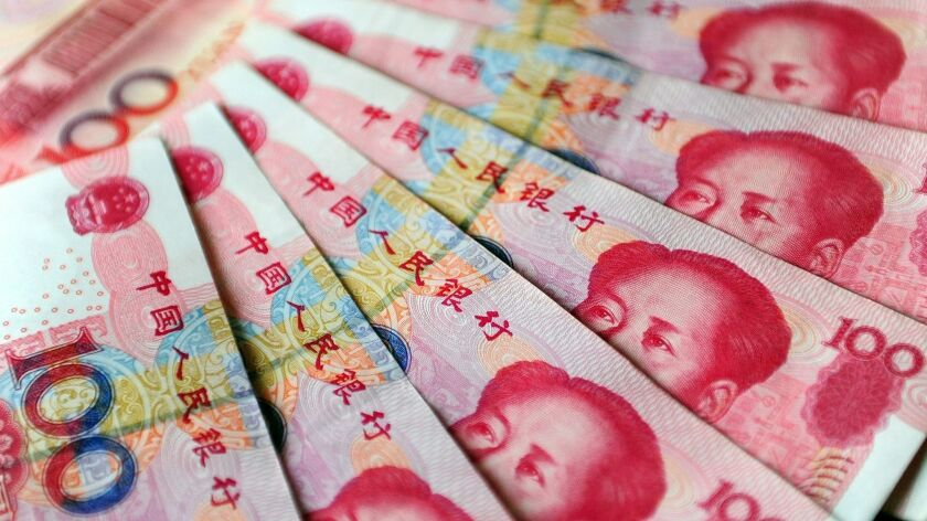 China's yuan has slid about 9% against the dollar in the last six months, making it one of the worst-performing Asian currencies this year.