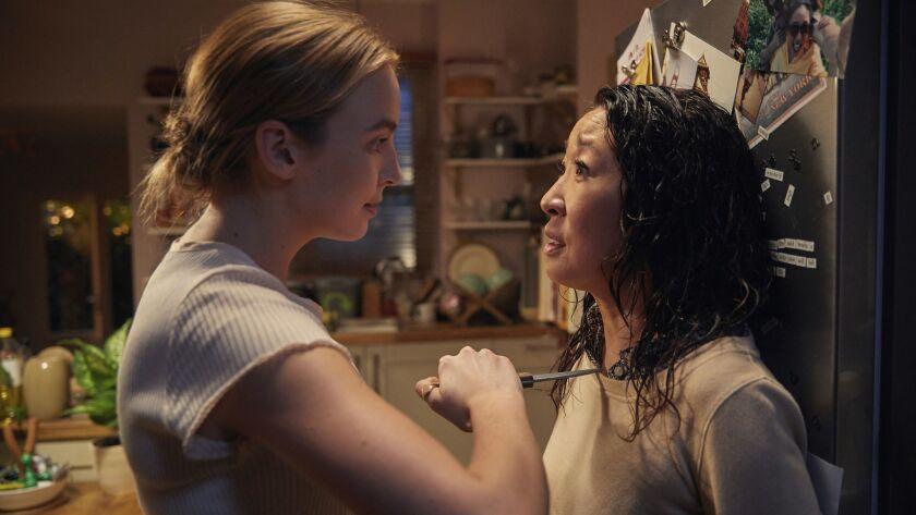 "Villanelle (Jodie Comer) and Eve (Sandra Oh) in the BBC America show ""Killing Eve."" Season: 1"