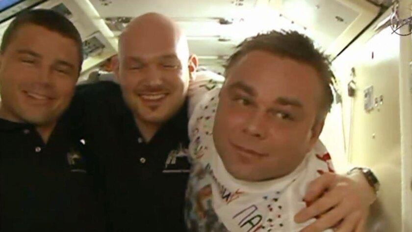 Reid Wiseman, left, Alexander Gerst and Maxim Suraev on the International Space Station.