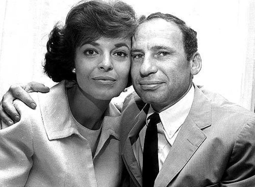 Newlyweds Anne Bancroft and Mel Brooks pose in New York in 1964.