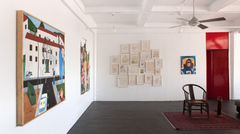 An installation view of early works by painter Henry Taylor in his namesake apartment gallery.