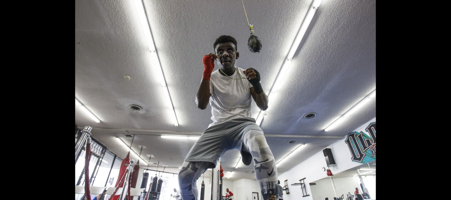 Yonis Muya shadow boxes during his daily workout.