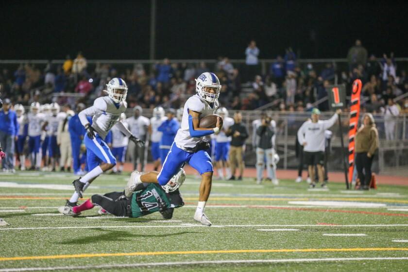 San Diego High QB Jadon Green runs for a 19-yard touchdown in the second quarter against Coronado.