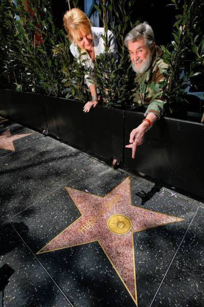 Actor Hugh O'Brian and his wife, Virginia, at the actor's star on the Hollywood Walk of Fame. O'Brian founded a nonprofit that helps teens set goals and become leaders.