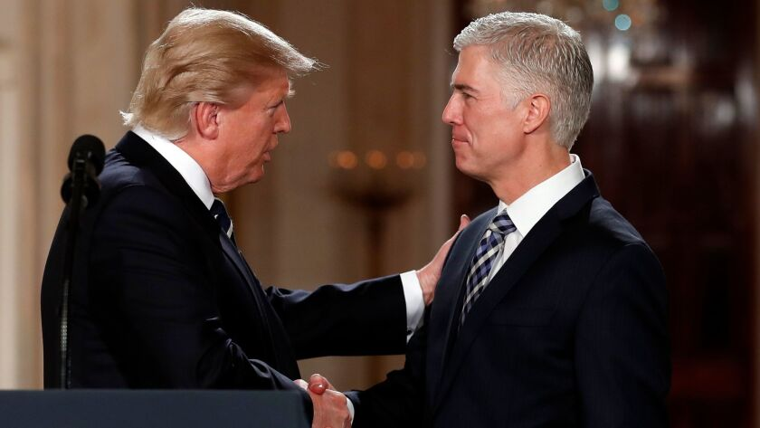 President Trump shakes hands with Neil Gorsuch, his choice for Supreme Court associate justice, in the White House on Jan. 31.