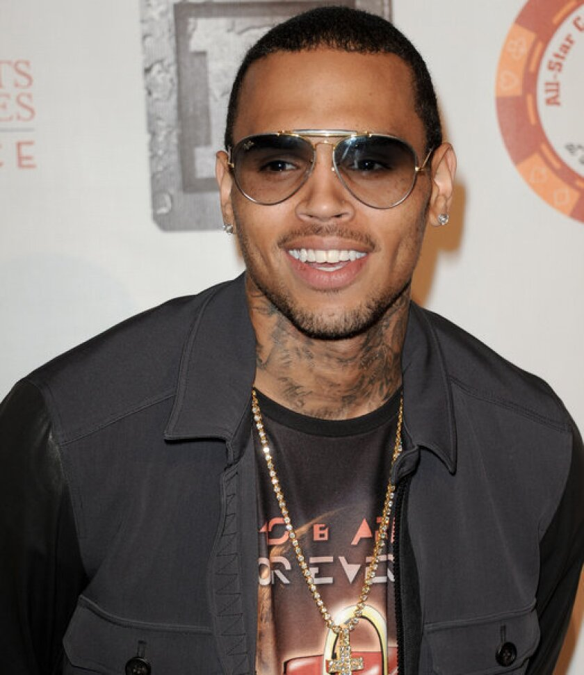 Chris Brown was sued Tuesday by a man who claims he was punched and kicked by a member of Brown's entourage during a fight at a West Hollywood recording studio.