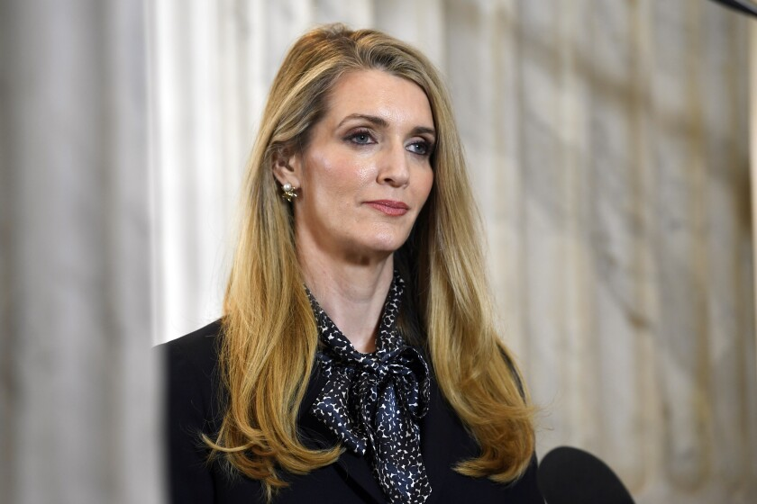 FILE - In this March 20, 2020, file photo, Sen. Kelly Loeffler, R-Georgia, waits to speak in a television interview on Capitol Hill in Washington. A pair of new high-profile endorsements are adding fuel to an already contentious special election for a U.S. Senate seat in Georgia. Former Gov. Nathan Deal has endorsed Republican Rep. Doug Collins in his bid to unseat Sen. Kelly Loeffler, a fellow Republican. Former president Jimmy Carter endorsed Democrat Raphael Warnock in the race. (AP Photo/Susan Walsh, File)