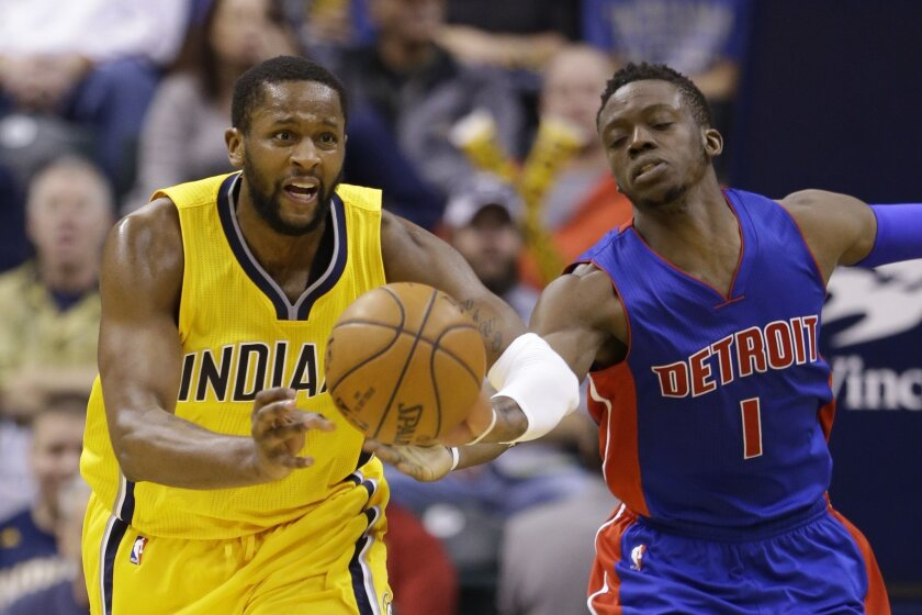 Indiana Pacers forward C.J. Miles (0) passes past of Detroit Pistons guard Reggie Jackson (1) during the second half of an NBA basketball game in Indianapolis, Saturday, Feb. 6, 2016. The Pacers defeated the Pistons 112-104. (AP Photo/Michael Conroy)