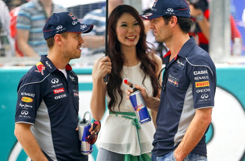 Formula One's Sebastian Vettel and Mark Webber take feud to China