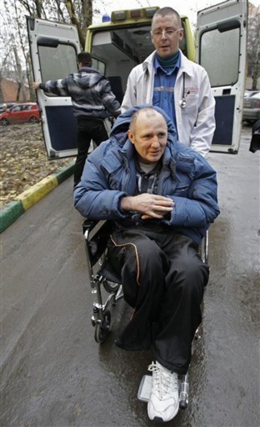 Journalist Mikhail Beketov, who was brutally beaten and left brain-damaged in 2008, is seen arriving at a court in Moscow's suburb of Khimki, Tuesday, Nov. 9, 2010. Beketov, a staunch critic of plans to cut down a local forest to build a highway, stands trial for libel against the town's mayor Vladimir Strelchenko. A reporter for a suburban Moscow paper was beaten up Monday, two days after another Moscow journalist was bludgeoned on the head, arms and legs in a brutal attack that was captured on video and has caused a national uproar. No motivation for either attack has been determined, but both men wrote about efforts to stop developers from cutting down trees in forests around Moscow to build highways. (AP Photo/Misha Japaridze)
